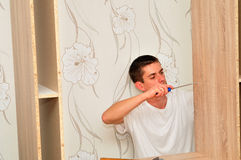 Family man assembling furniture. Stock Images