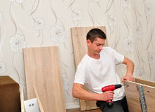 Family man assembling furniture. Royalty Free Stock Photo