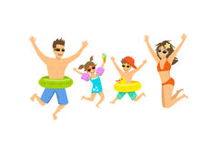 Family, man woman boy girl, parent and their children jumping for joy, happy to be on vacations. On a beach Royalty Free Stock Photography