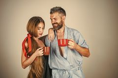 Family of man and woman with red milk cup. Royalty Free Stock Photos