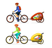 Family, Man and Woman with their  his children traveling cycling together with kids trailers Royalty Free Stock Images