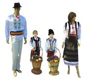 Family Mannequins in national traditional balkanic, moldavian, r. Omanian costumes isolated over white background stock images