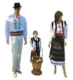 Family Mannequins in national traditional balkanic, moldavian, romanian costumes isolated over white. Background stock photos