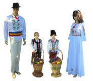 Family Mannequins in national traditional balkanic, moldavian, romanian costumes isolated over white. Background stock image