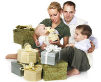 Family with many gift boxes Royalty Free Stock Photo