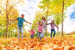 Family with many kids run in autumn park Royalty Free Stock Photography