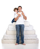 Family and many mattresses Stock Photography