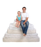 Family and many mattresses Stock Photo