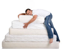 Family and many mattresses Stock Images
