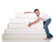 Family and many mattresses Royalty Free Stock Photos