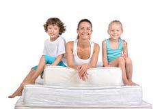 Family and many mattresses Royalty Free Stock Photo