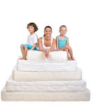 Family and many mattresses Royalty Free Stock Image