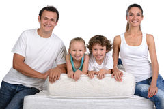Family and many mattresses Royalty Free Stock Images