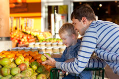 Family at the market. Cheerful family of two at the farmers market Stock Photo