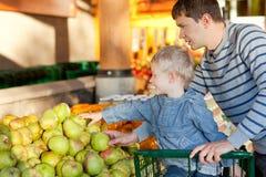 Family at the market Stock Photo