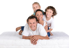 Family on the mattress Royalty Free Stock Photography