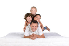 Family on the mattress Stock Images