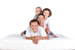 Family on the mattress Royalty Free Stock Image