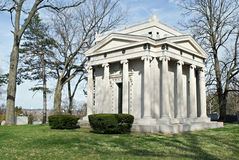 Family Mausoleum. Classical-style mausoleum with ionic columns stands to hold members of a family Stock Image