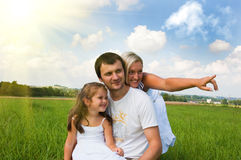 Family on meadow Royalty Free Stock Images