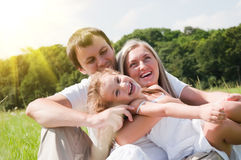 Family on the meadow Royalty Free Stock Images