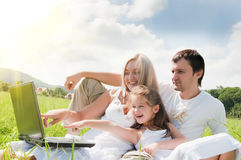 Family on the meadow Stock Images
