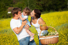 Family on the meadow Stock Image