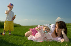 Family in the meadow Stock Photos