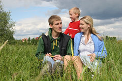 Family on meadow Royalty Free Stock Photo