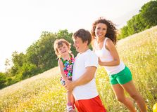 Family on the meadow Royalty Free Stock Image