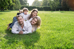 Family at the meadow Stock Photo