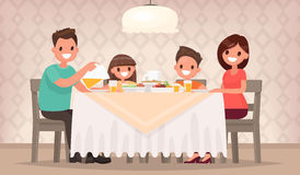 Family meal. Father mother, son and daughter together sit at the Royalty Free Stock Photo