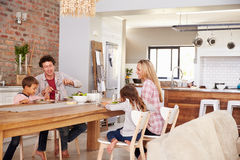 Family mealtime at home Royalty Free Stock Image