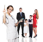 Family on medical examination with young doctor Stock Photography