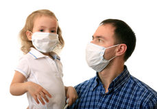 Family in medical masks. Dad with daughter in non-permanent medical masks Royalty Free Stock Photo