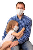 Family in medical masks with a thermometer. Royalty Free Stock Photo