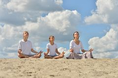 Family meditate over blue cloudy Royalty Free Stock Images