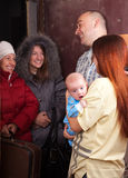 Family  is meeting a kinsfolk. Family of three is meeting a kinsfolk at home Royalty Free Stock Photo
