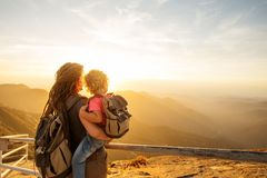 Family meets the sunset on the Moro rock in Sequoia national park, California, USA.  royalty free stock photography
