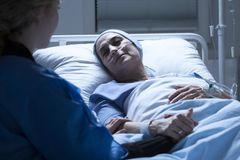 Family member and sick woman. Family member taking care of a sick women with leukemia royalty free stock photo