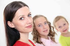 Family members. Portrait of mother with two children,looking at camera - close up Stock Photo