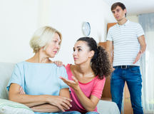 Family members asking senior mother to forget offences Royalty Free Stock Photography