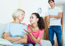 Family members asking senior mother to forget offences Stock Photo