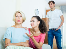 Family members asking senior mother to forget offences Royalty Free Stock Images