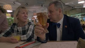 Family members toasting while having dinner in restaurant stock footage