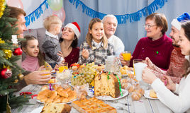Family members making conversation during dinner. Family members making conversation during Christmas dinner Stock Photo
