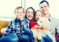 Family members spending quality time together. Cheerful family members spending quality time together at home royalty free stock photos