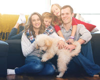 Family members spending quality time together. Happy young family members spending quality time together at home royalty free stock images