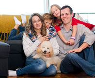 Family members spending quality time together. Smiling young family members spending quality time together at home royalty free stock images
