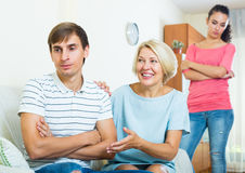 Family members trying to make it out with offended man Royalty Free Stock Photography